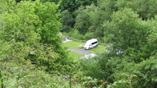 View of the site…and the chucklebus, from the approach lane to Cynwyd Forest